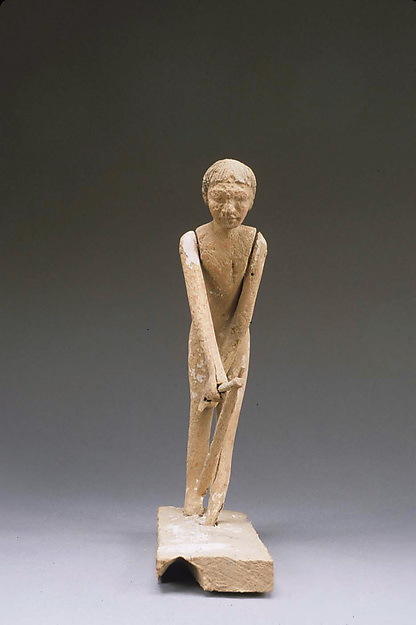 Statue of man hoeing from tomb of Tjeteti