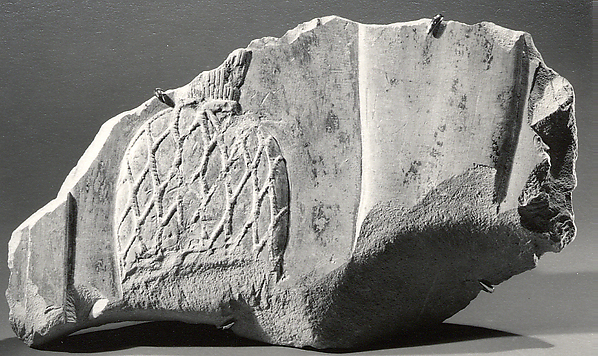 Relief fragment of a perfume press