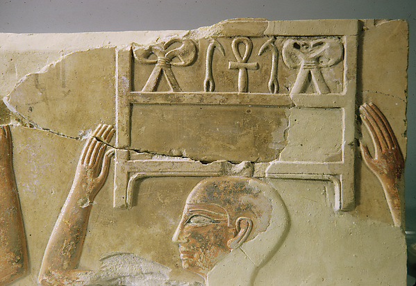 Relief of men carrying chests of linen