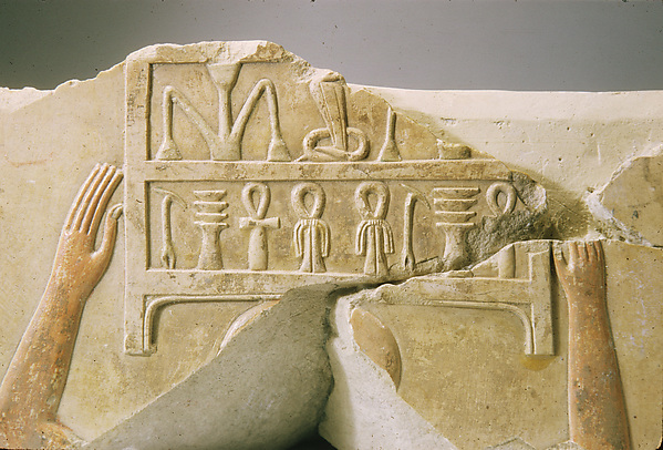 Relief of men carrying chests of linen