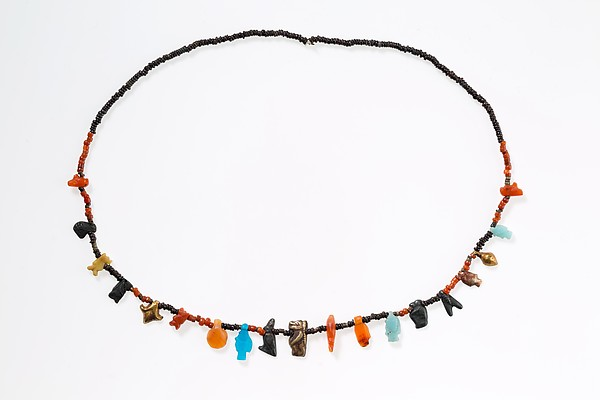 Necklace with disc beads and amulets