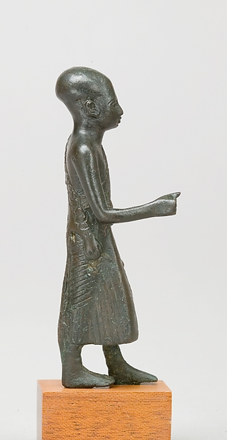 Priest in a leopard skin cloak with an inscription and Osiris on his skirt