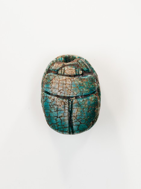 Scarab depicting a kneeling man (?)