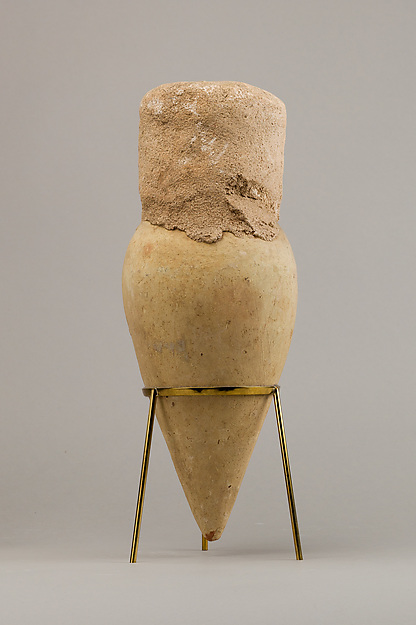 Jar with pointed base and intact seal