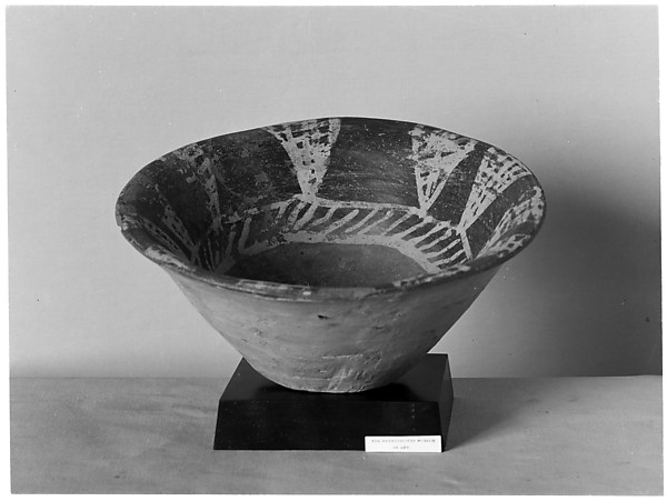 White cross-lined bowl with geometric design