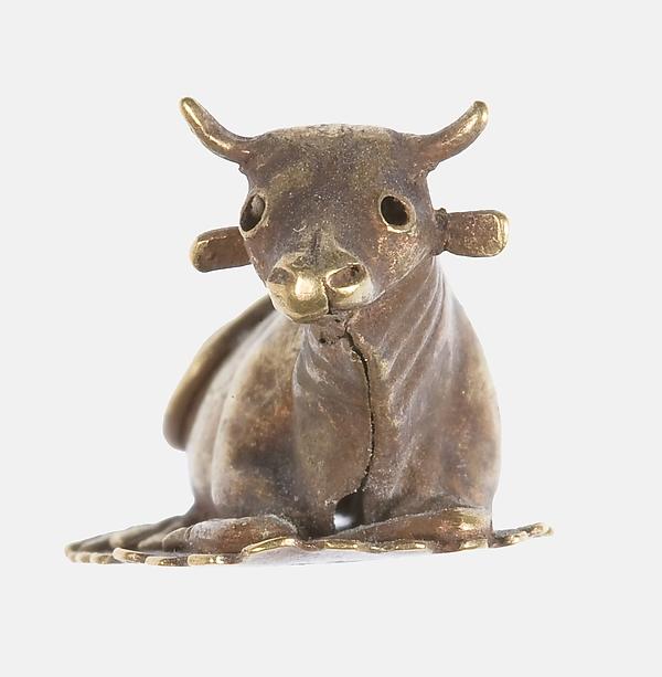 Resting bovine figurine