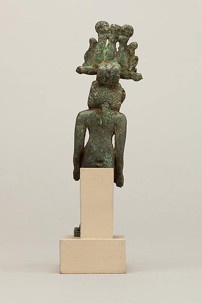 Harpokrates, seated, in nemes and hemhem