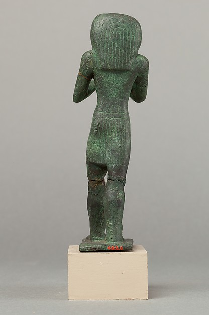 Statuette of Horus with a vessel