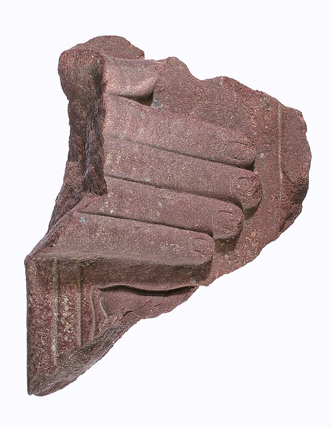 Hand from a stelophorous statue with part of the Horus name of Akhenaten (?)