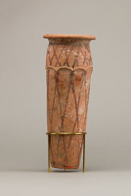 Wavy-handled jar with cross hatching design