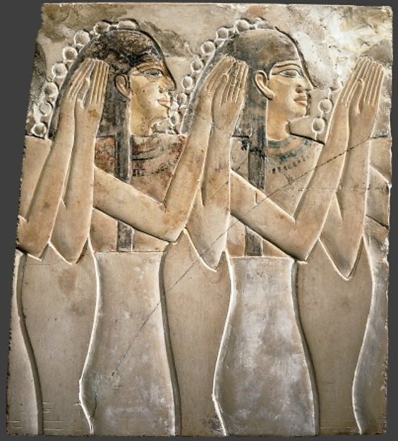 Relief of Clapping Women