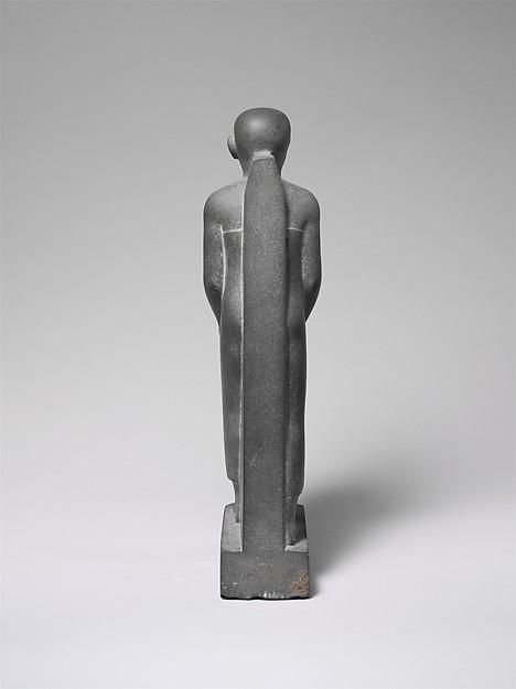 Man Holding a Shrine Containing an Image of Osiris