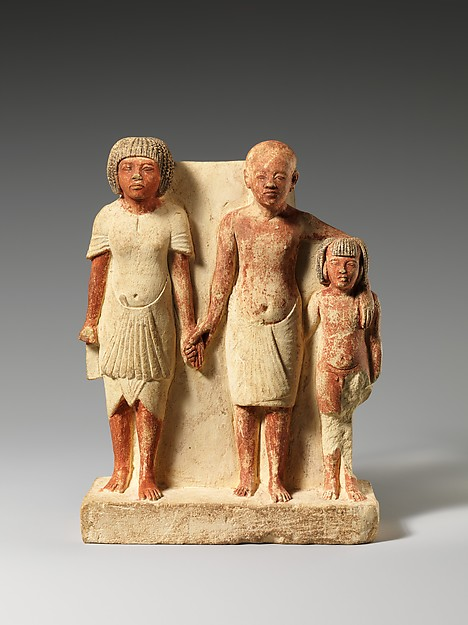 Statue of two men and a boy that served as a domestic icon