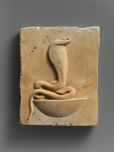 Relief plaque of cobra on a neb basket