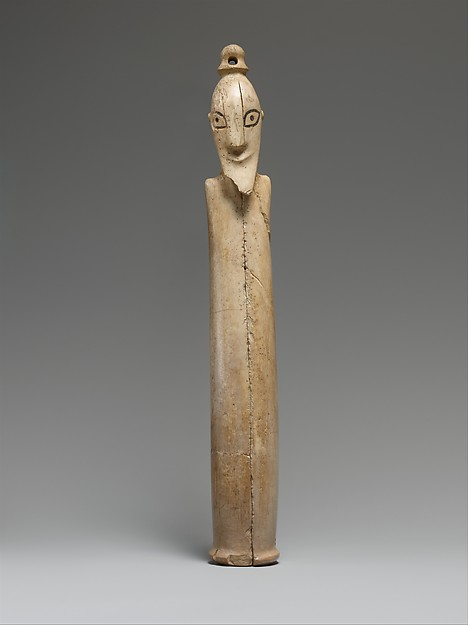 A Tusk Figurine of a Man