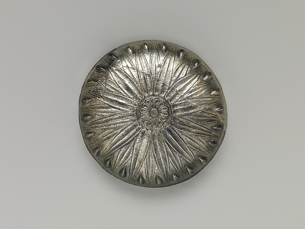 Bowl with bosses and lotus pattern and demotic weight on rim