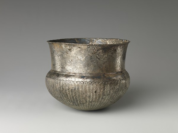 Bowl with flutes f rom shoulder to rosette at base and with inscribed weight