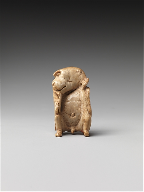 Game piece in the shape of a baboon