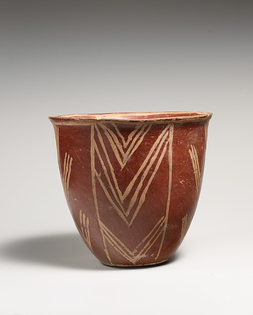 White cross-lined ware bowl with geometric patterns