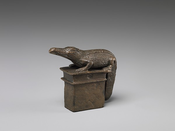 Crocodile on a shrine-shaped base
