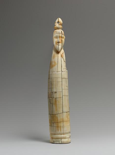 Tusk figure of a man