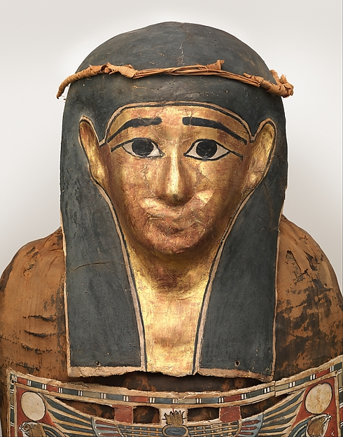 Mummy of Nesmin with plant wreath, mummy mask and other cartonnage elements