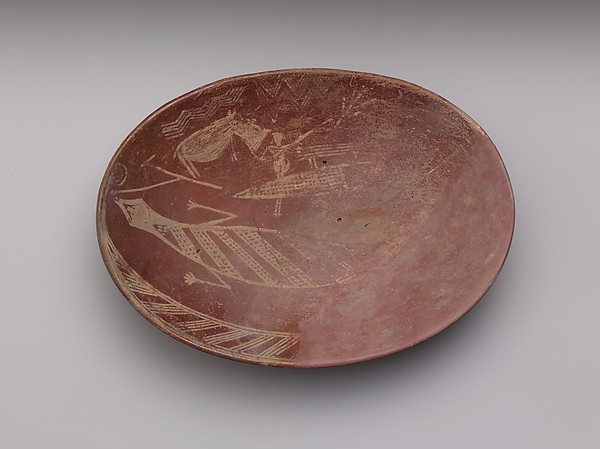 A shallow white cross-lined ware bowl illustrating a man on a boat alongside a hippo and crocodile