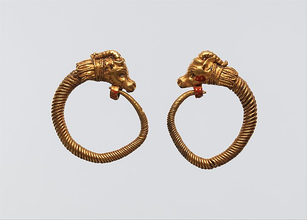Earrings with ibex head terminal