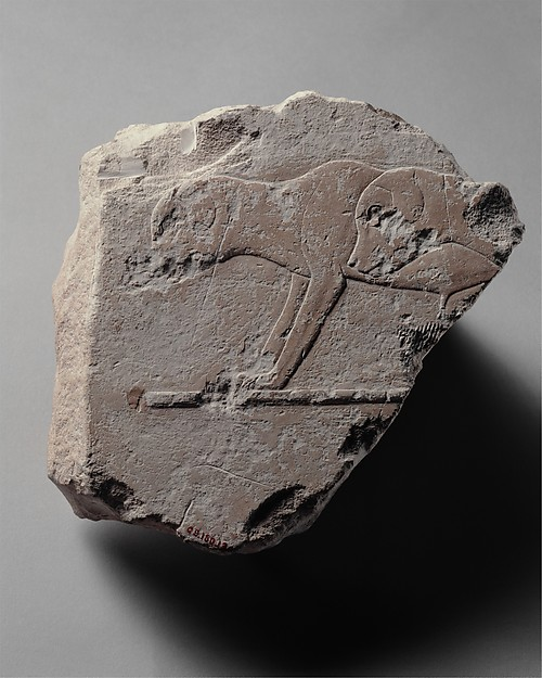 Relief fragment with two young dogs