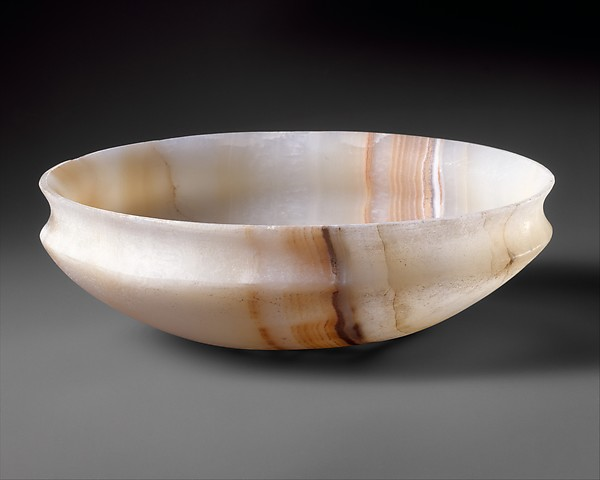 Shallow bowl with a recurved rim