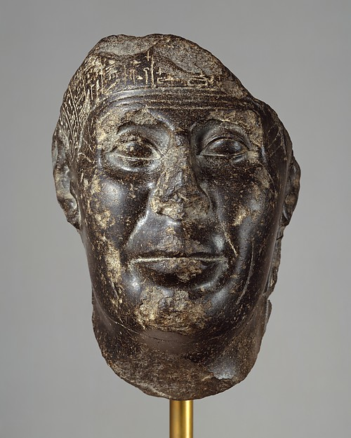 Head from a Statue with Magical Texts