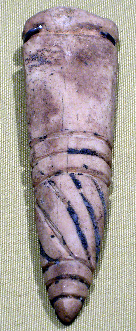 Tag amulet in the form of a tusk