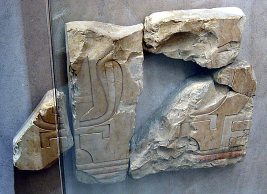 Relief fragments of two sacred emblems