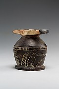 Kohl jar decorated wtih Horus falcon and grotesque figure