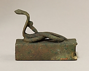 Box for an animal mummy surmounted by a coiled, rearing snake