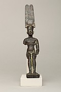Child god wearing Amonian crown and named Horus of Mednit (Aphroditopolis)