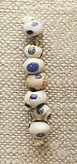 String of 7 Eyed Beads