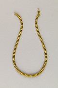 String of 115 discoid ridged beads