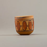 Cup with geometric decoration