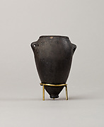 Black polish ware jar with lugs