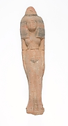 Standing female figurine wearing large headdress and wax cone