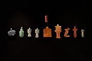 10 Amulets of Henettawy (C): 1 wedjat, 1 scarab, 3 djed pillars, 1 incised plaque, 1 uraeus, 2 wadj signs, and 1 cylindrical bead