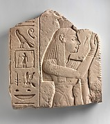 Relief of a goddess offering a palm rib