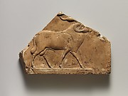Relief plaque with ram, and on opposite side two feet