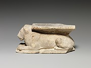 Incomplete sculpture of recumbent lion