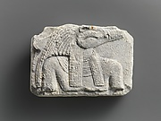 Relief plaque, upper part of crocodile-headed god