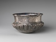 Bowl with acorn bosses at shoulder, lotus pattern beneath, and rosette on bottom, and with inscribed weight