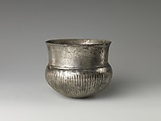 Bowl with flutes f rom shoulder to rosette at base