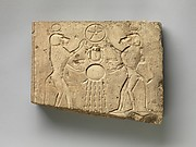 Relief panel showing two baboons offering the wedjat eye to the sun god Khepri, who holds the Underworld sign