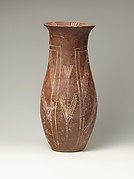 White cross-lined ware vase with plant designs